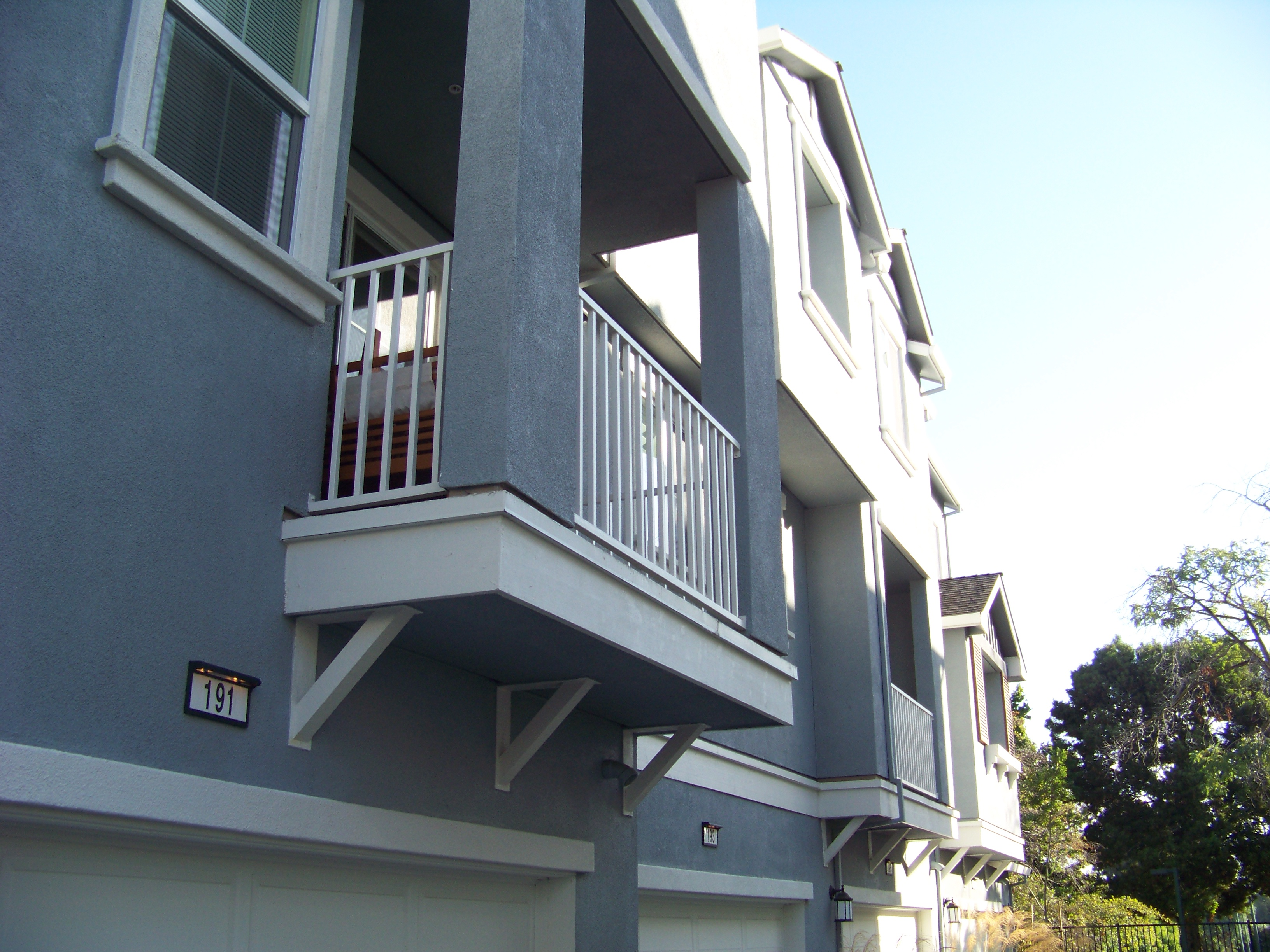 Ebm construction inc projects bedford square by pulte for Steel balcony